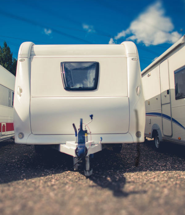 pull behind camper trailer in storage with others