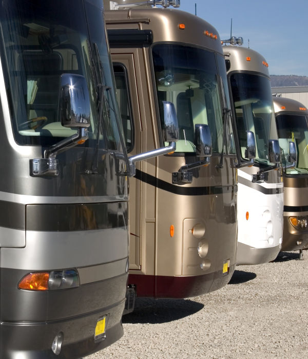 Many coach motorhomes in a row at our Bradenton RV storage